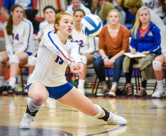 Apollo's Sarah Bennett bumps the ball against Alexandria during the third game Thursday, Sept. 20, at Apollo High School.