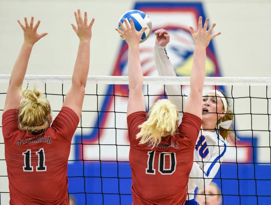 Apollo's Haley Schleper spike the ball against Alexandria during the second game Thursday, Sept. 20, at Apollo High School.