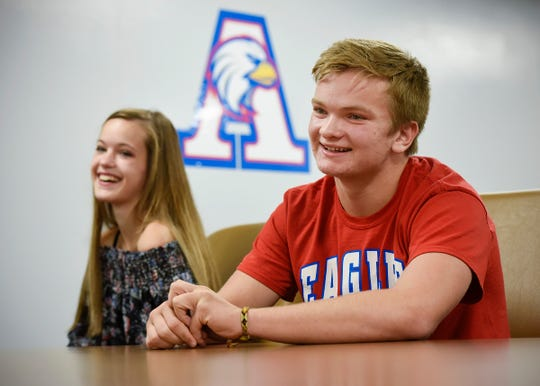 Seniors Caitlin Peterson and Isaac Erickson-Thoemke talk about working remotely on technology devices since the start of school Friday, Sept. 21, at Apollo High School.