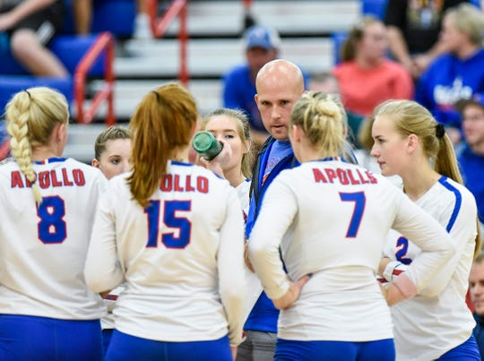 Apollo coach Sean Roquette talks with players during a time out against  Alexandria during the first game Thursday, Sept. 20, at Apollo High School.