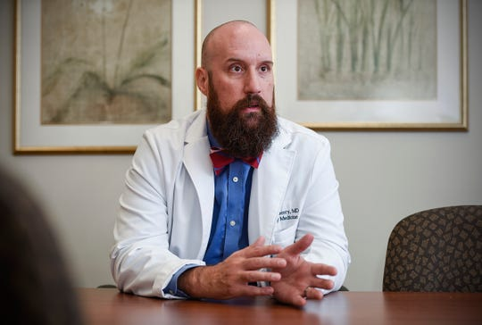 Dr. Sean Wherry, CentraCare Clinic in St. Joseph, explains the online process Thursday, Sept. 20, how patients can contact a CentraCare eClinic health care professional online 24/7 with common medical problems including video chats.