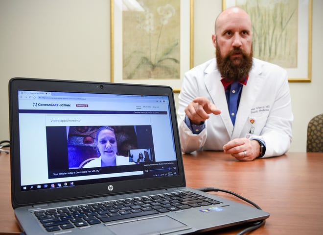 Dr. Sean Wherry demonstrates a video chat with a health care professional Thursday, Sept. 20, at the CentraCare Clinic in St. Joseph. Patients can contact a CentraCare eClinic health care professional available online 24/7 with common medical problems.