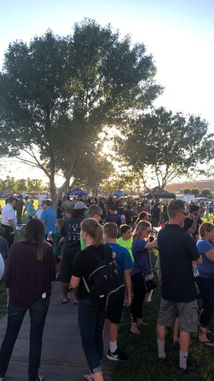 Residents mill around the grounds at the Mesquite Recreation Center during Mesquite Night Out on Sept. 19, 2018.