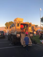Kids pile into the Mesquite Police SWAT Incident Command vehicle at Mesquite Night Out on Sept. 19, 2018.