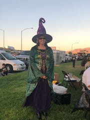 Becki Stepp dressed as a witch at Mesquite Night Out to tout next month's Trunk or Treat, which will be on Halloween.