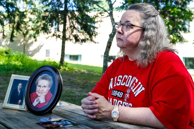 Nancy Roppe talks about the Portage County Health Care Center's impact on members of her family, pictures at left, outside of the center in Stevens Point, Wis., August 10, 2018.