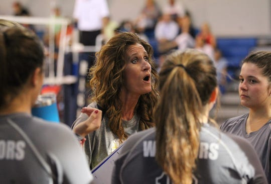 Aucilla volleyball coach Cathy Rogers talks to her team as Aucilla Christian plays at Maclay in a high school volleyball game on Thursday, Sept. 20, 2018.