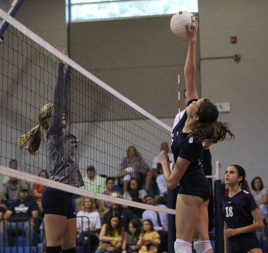 Maclay's Katerina Krizner kills a ball as Aucilla Christian plays at Maclay in a high school volleyball game on Thursday, Sept. 20, 2018.