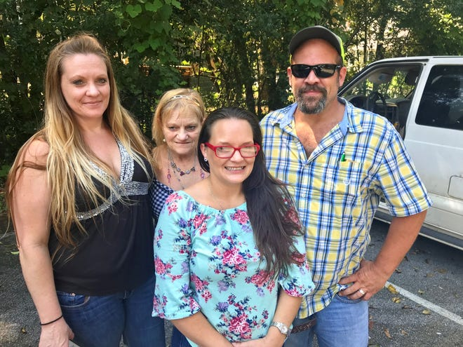 Members of the Middleton and Helms families pose for a photo. They were upbeat following news that the Jackson County deputy who arrested their loved ones was fired and under investigation for planting drugs on unsuspecting drivers. Pictured, from left, are April Middleton, her mom Maudry Middleton, Erika Helms and Grady Helms.
