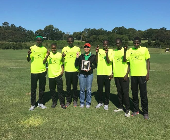 FAMU's men's cross country team celebrates a landslide victory in the Falcon Classic. From left to right: Brian Kiprop, Festus Kemboi, David Too, coach Darlene Moore, Fedrick Kemboi and Jacob Nkamasiai.