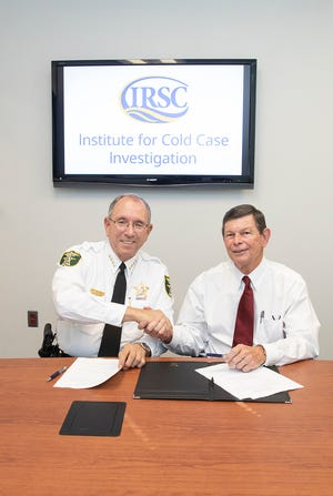Martin County Sheriff William Snyder and IRSC President Dr. Ed Massey sign an agreement recognizing MCSO as the Institute for Cold Case Investigation's first law enforcement agency partner.