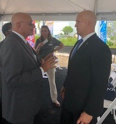 Pete Antonacci, chief executive officer and president, Enterprise Florida talks with Mayor Gregory Oravec, City of Port St. Lucie, at the TAMCO groundbreaking.