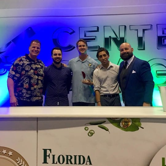 Twisted Tuna bar manager Garett Hagan, wins the 2018 HIP SIP Battle of the Modern Bartender competition at the Florida Restaurant and Lodging Show in Orlando.