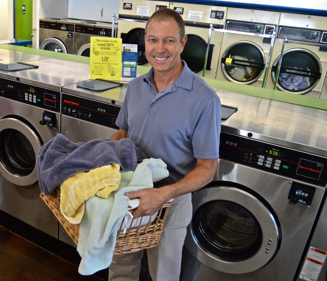 Tom Rhodes, co-owner of Sunshine Laundries, is donating money to United Against Poverty generated by a selected washer at five of their locations from now until Dec. 31.