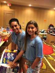Alicia Estrella and Jordan Powell helped pack toiletries at the event.