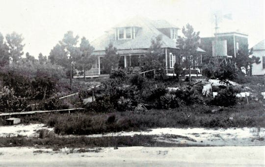 The Kitching House behind the Broster Kitching P. O. Showing Atwood House. Postcard dated 9-11-10.