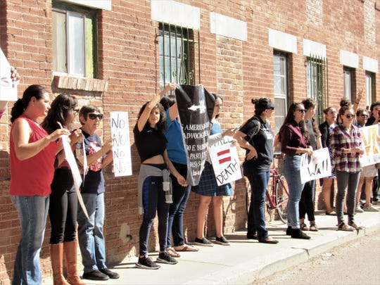 Protesters chant just outside the site of a news conference near the Chihuahuita neighborhood of El Paso during which Border Patrol El Paso Sector Chief Aaron A. Hull on Friday announced that construction to replace fencing with a new 18-foot-high steel bollard wall will begin Saturday. The $22 million project is expected to be completed in April. The 4-mile section of wall will run from just west of the Paso Del Norte Bridge to the Fonseca Road area.