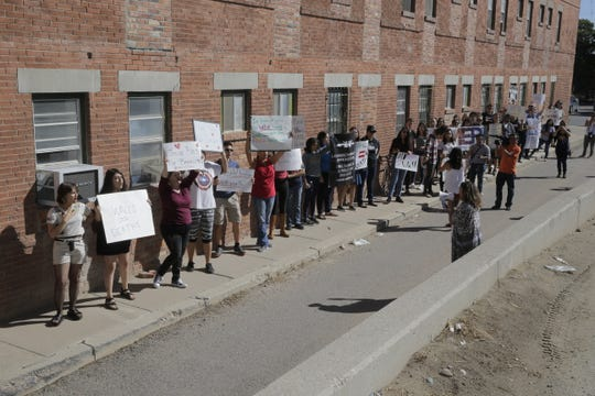Protesters jeered plans for the construction of a border wall in the Chihuahuita neighborhood of El Paso, Texas. The Border Patrol announced details of the plan at a press conference Friday, Sept. 21.