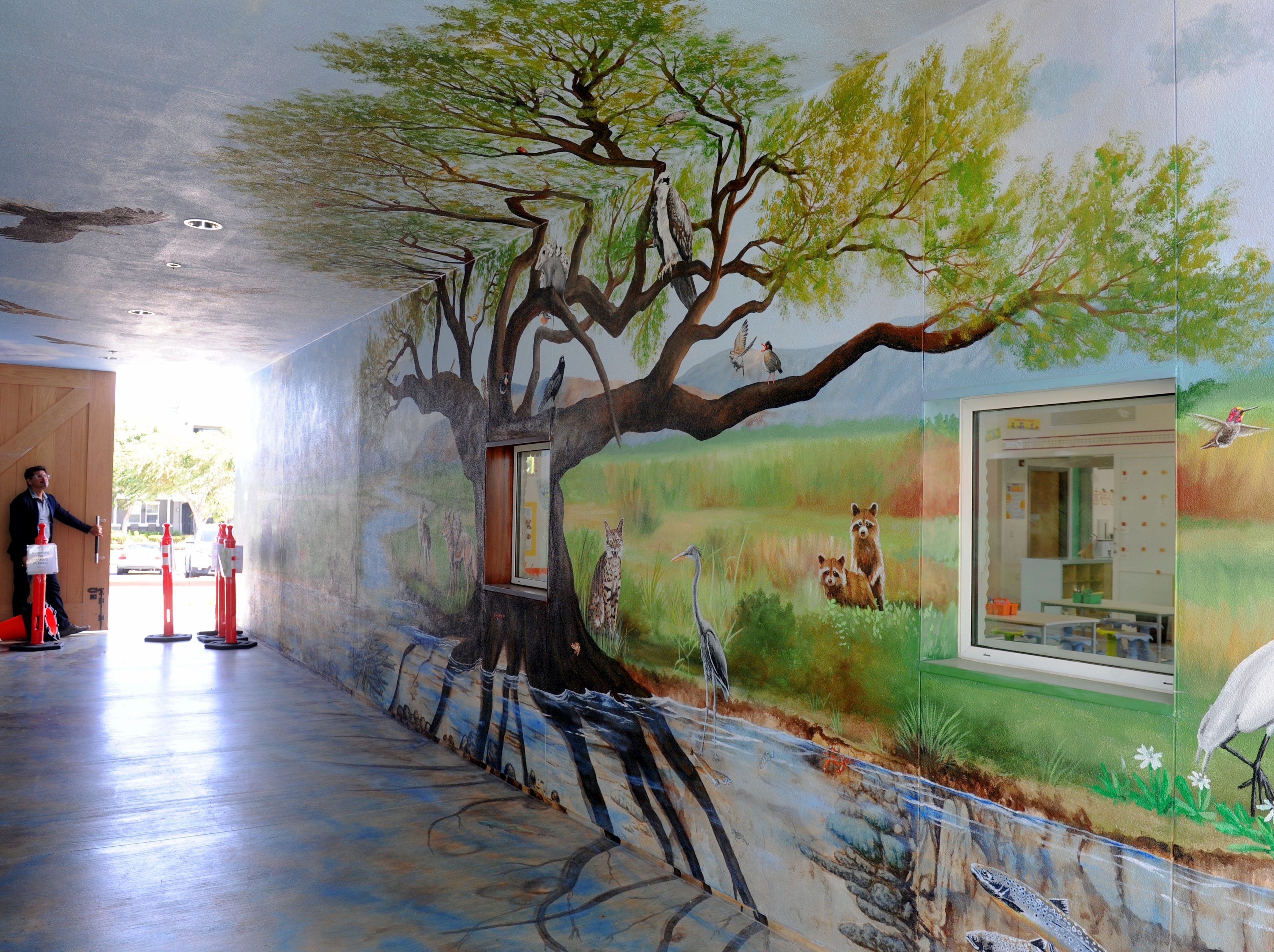Principal Ralph Cordova walks through the hallway at Rio Del Sol school in Oxnard.