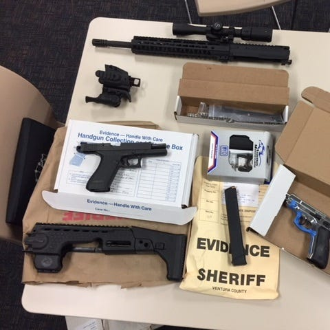 Some of the evidence seized during a firearm search warrant in Oxnard.
