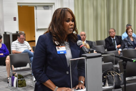 Gloria Gammage, chief nurse executive at St. John's Regional Medical Center in Oxnard, testifies in favor of a hospital system merger.
