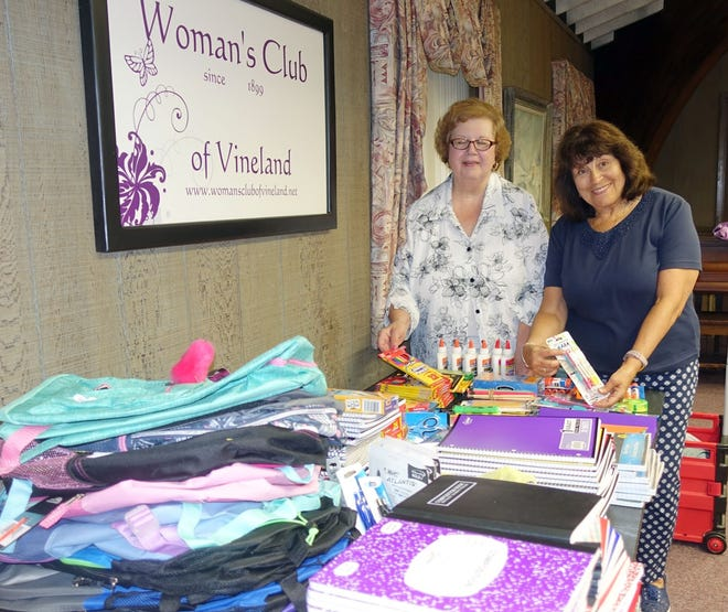 Rita Galasso (left) and Linda Gallina, members of the Woman's Club of Vineland, get ready to box up school supplies donated by club members for delivery to the Boys & Girls Club of Vineland.