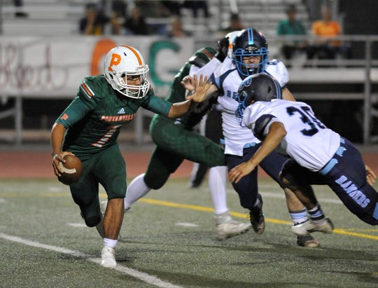 Porterville quarterback Hector Nava Jr. puts his hand up for the block against Redwood in a non-league game at Jacob Rankin Field in Porterville on September 20, 2018.