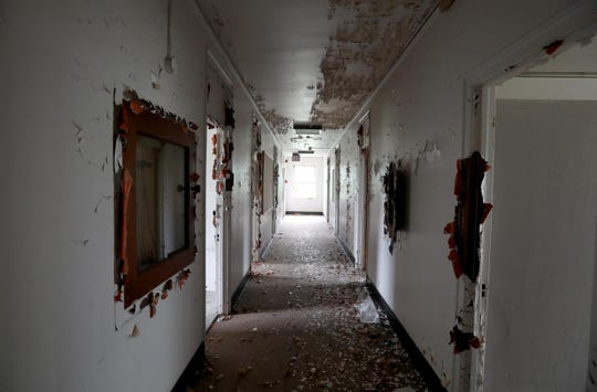 A corridor in Wilbur Hall, one of the long boarded up, decrepit buildings on the campus of Letchworth Village in Stony Point Sept. 21, 2018. Stony Point Supervisor Jim Monaghan gave an update on the status of plans to develop the site. The plans would include knocking down several of the boarded up buildings, including Wilbur Hall.