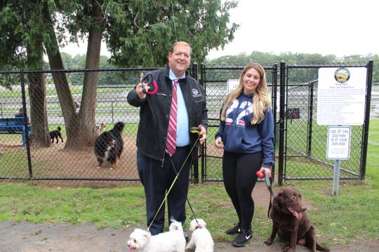 Clarkstown Supervisor George Hoehmann, with his dogs Ollie and Livvy, and Megan Leavey and her dog Patriot, during the dedication ceremony for the town's dog park on Sept. 21, 2018