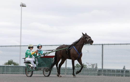 Lohud sports reporter Nancy Haggerty learns to harness drive with driver Jim Marohn Jr. and Art History the horse at Yonkers Raceway Sept. 20, 2018.