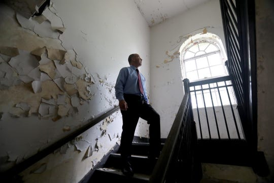 Stony Point Supervisor Jim Monaghan stands in a stairwell in Wilbur Hall, one of the long boarded up, decrepit buildings on the campus of Letchworth Village in Stony Point Sept. 21, 2018. Monaghan gave an update on the status of plans to develop the site. The plans would include knocking down several of the boarded up buildings, including Wilbur Hall.