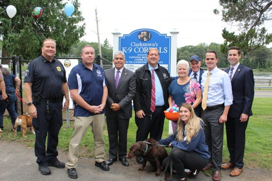 Clarkstown Police Chief Raymond McCullagh, Town Council members Peter Bradley and Frank Borelli, Town Supervisor George Hoehmann, town recreation Superintendent Elaine Apfelbaum, Council member Don Franchino, state Sen. David Carlucci, state Assemblyman Ken Zebrowski; and  Patriot, Megan Leavey and her dog Patriot. The town's dog park was dedicated on Sept. 21, 2018.