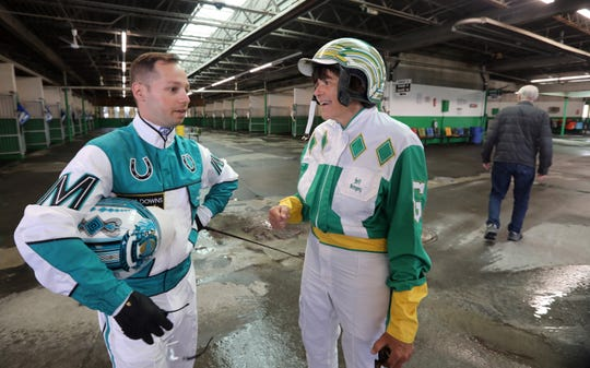 Lohud sports reporter Nancy Haggerty chats with harness driver Jim Marohn Jr. before her lesson at Yonkers Raceway Sept. 20, 2018.