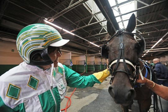 Lohud sports reporter Nancy Haggerty greets horse Art History before going out with him at Yonkers Raceway Sept. 20, 2018.