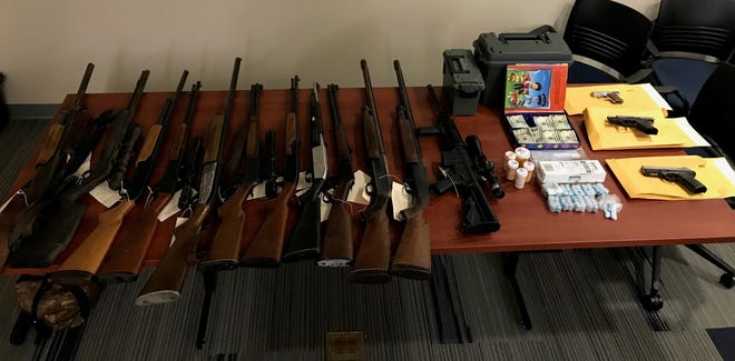 When searching a Harrington home where police said drugs were being sold, they foundfive shotguns, seven rifles, three handguns and more than 660 bags of heroin.