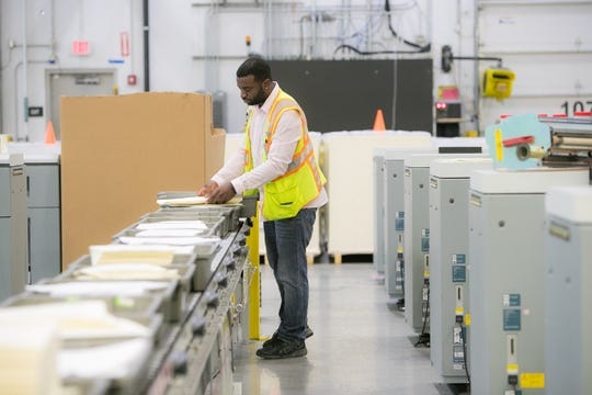 A worker at the Amazon facility in Middletown