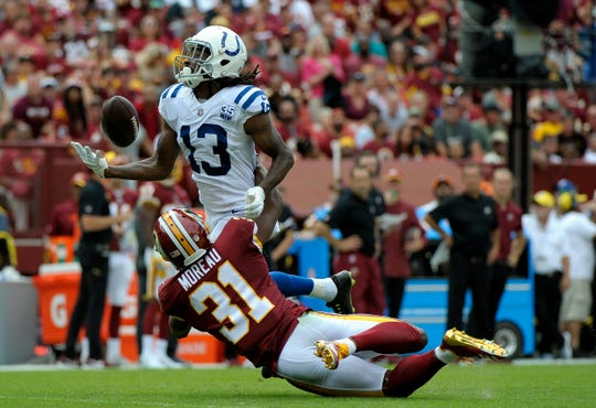 Indianapolis Colts wide receiver T.Y. Hilton (13) is unable to catch a pass attempt as he is pressured by Washington Redskins cornerback Fabian Moreau in the first half of an NFL football game, Sunday, Sept. 16, 2018, in Landover, Md. (AP Photo/Mark Tenally)