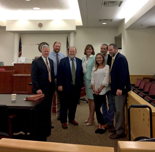 Bianka and Vern Landavazo pose for a photo with the prosecution team after Kody Lott was sentenced to life in prison for murdering their daughter, Lauren, in September 2018 in a Fort Worth courtroom.