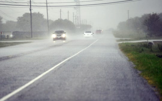 Periods of torrential rain accompanied steady showers on Sept. 21 in North Texas as these drivers traverse State Highway 79.