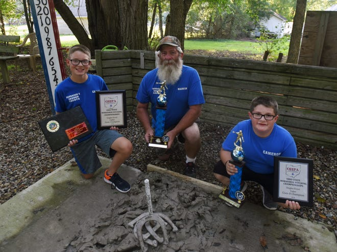Caiden Hogue (left), his grandfather, Marvin Paul (center), and younger brother, Cameron (right), all placed in this year's state and world horseshoe championships. Caiden was the first family member to start pitching and became the influence for the rest of the family to also participate in the sport.