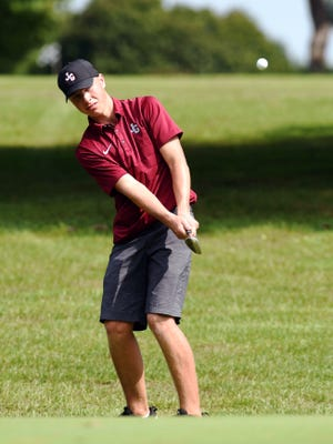 John Glenn's Derek Graham chips on to the 18th green during the Muskingum Valley League Tournament on Friday at Jaycees. Graham shot 77, one of the only scores in the 70s, as the Muskies earned the league title.
