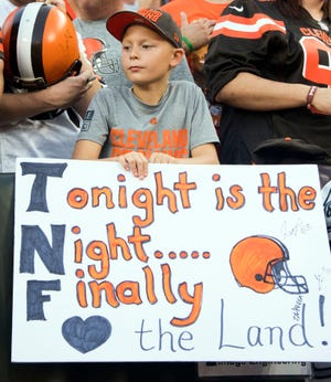"A young Cleveland Browns fan holds a sign referencing the Browns' winless streak and before the ""Thursday Night Football"" game against the New York Jets at FirstEnergy Stadium. The Browns won the game, 21-17, ending a 19-game winless streak."