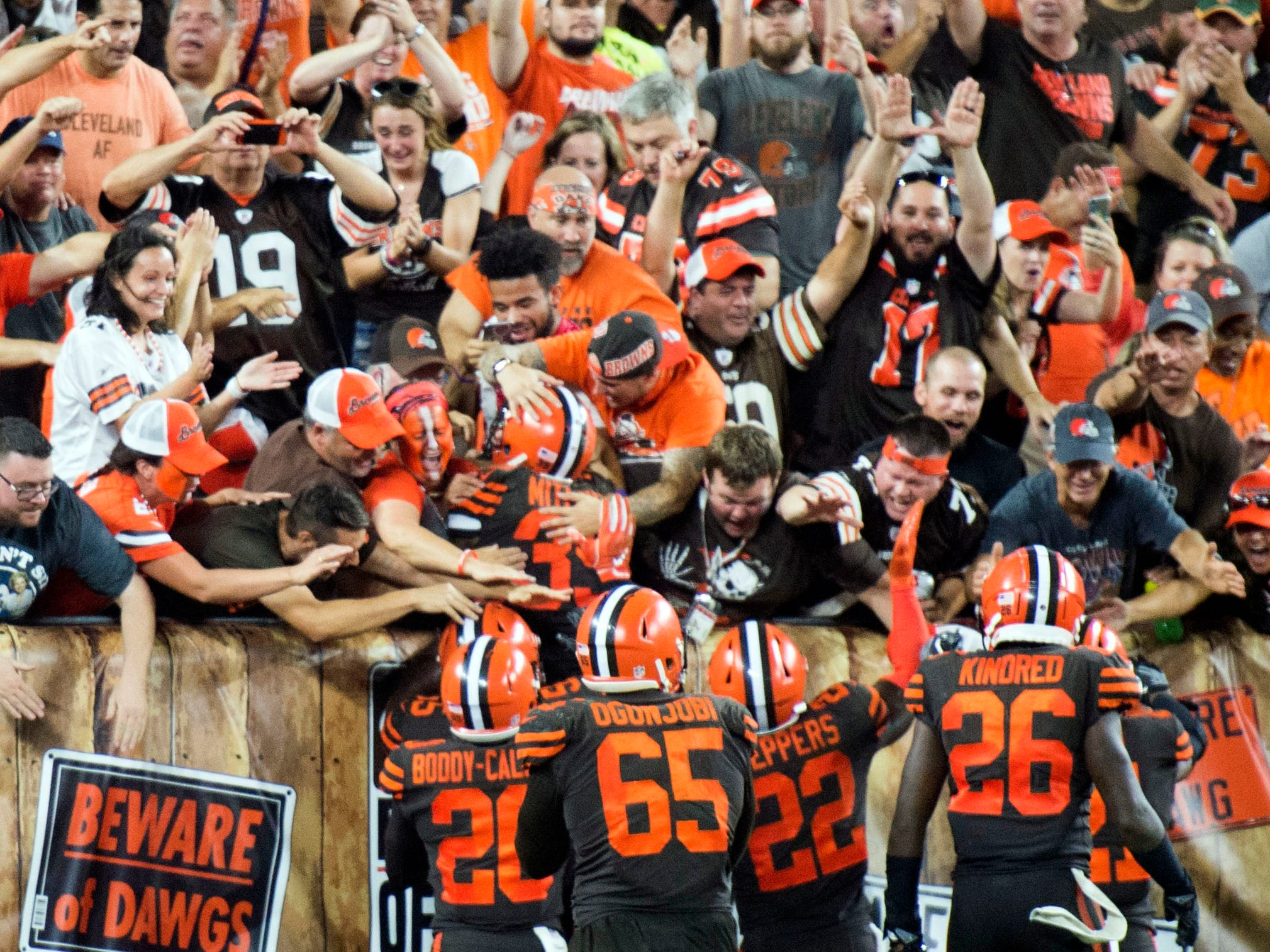 Members of the Cleveland Browns celebrate with fans after they beat the against the New York Jets at FirstEnergy Stadium.
