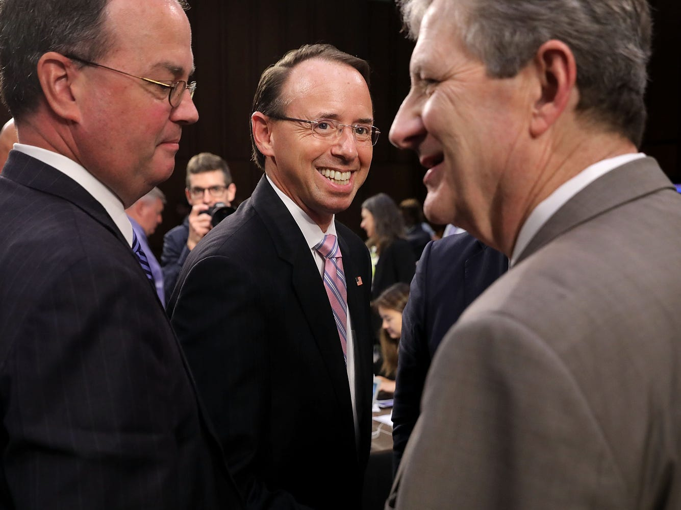 Deputy Attorney General Rod Rosenstein (C)  is all smiles at the  the Supreme Court confirmation hearing for Judge Brett Kavanaugh.