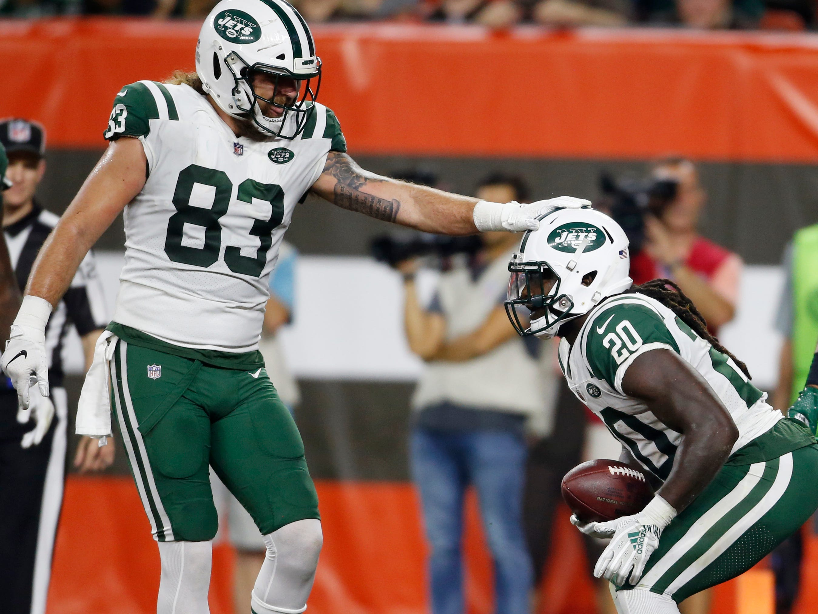 New York Jets tight end Eric Tomlinson congratulates running back Isaiah Crowell after Crowell ran for a 2-yard TD.