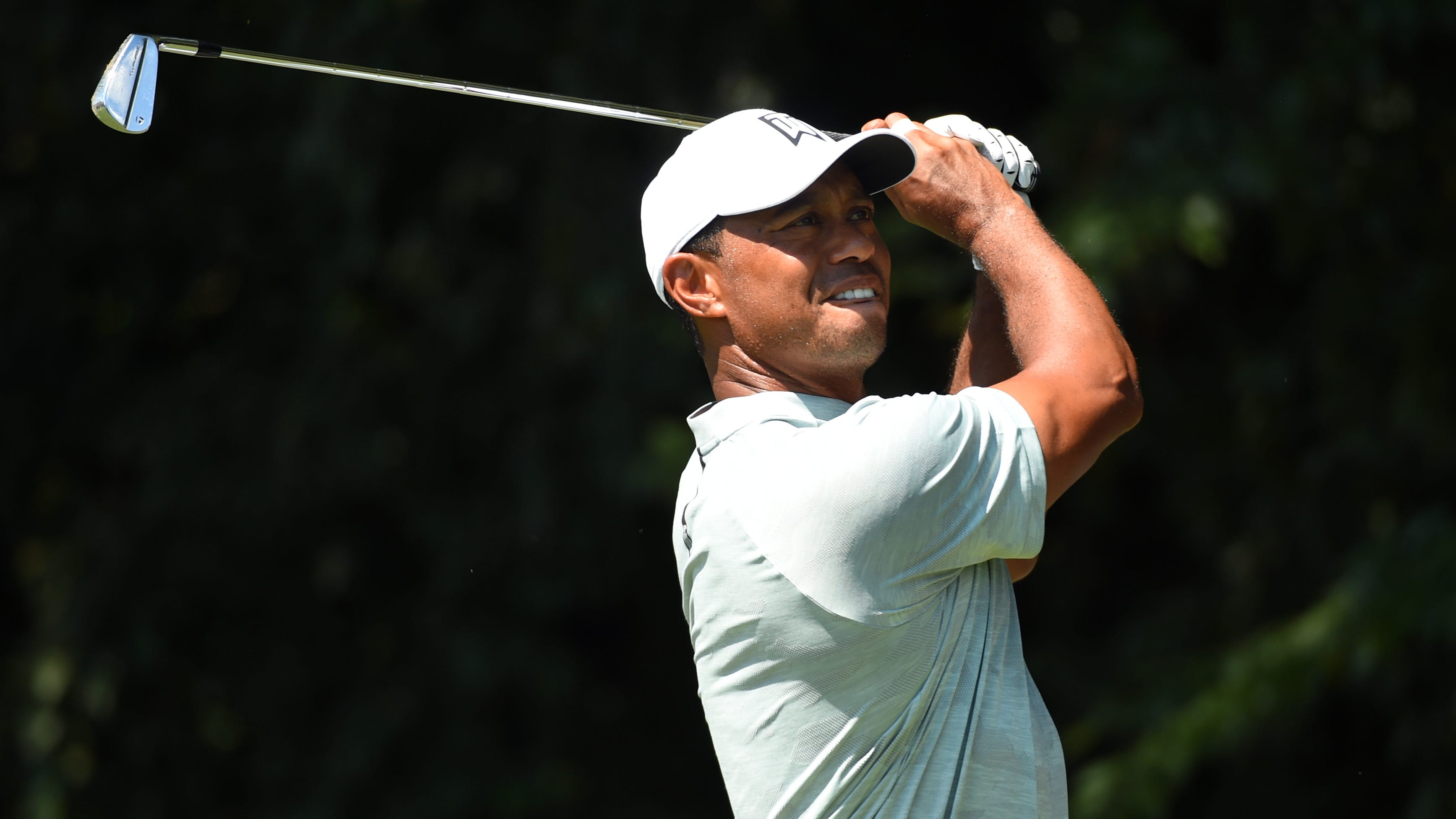 Tiger Woods tees off on the second hole during the second round of the Tour Championship golf tournament at East Lake Golf Club.