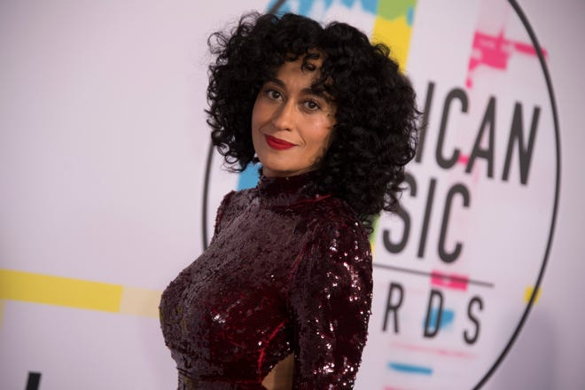 Ellis Ross returns to host the American Music Awards on Tuesday.