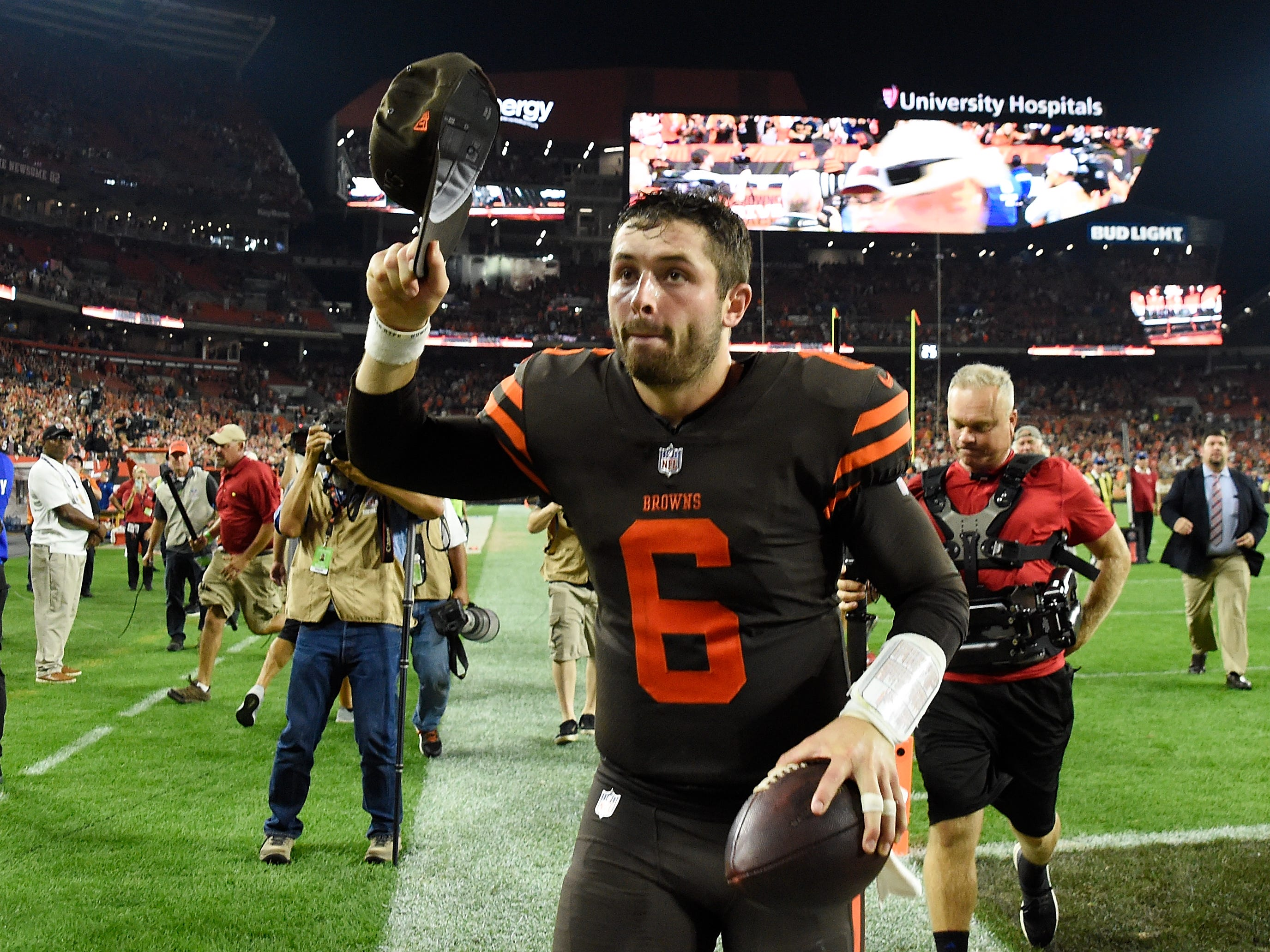 Baker Mayfield runs off the field after the Browns' 21-17 win over the Jets at FirstEnergy Stadium.