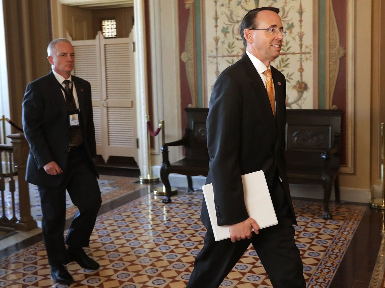 The Deputy Attorney General leaves the U.S. Capitol following a closed-door briefing with members of the House of Representatives on May 19, 2017.