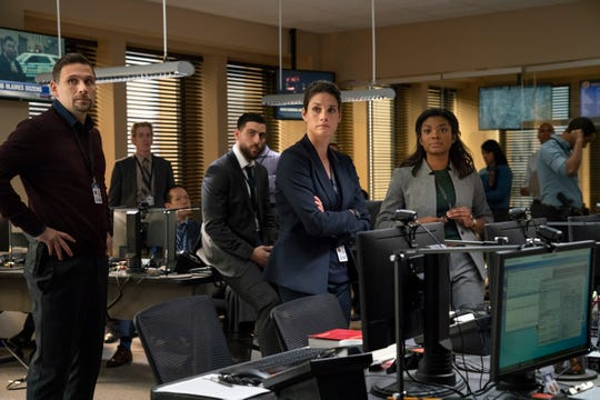 "Jeremy Sisto, left, Zeeko Zaki, leaning on desk, Missy Peregrym and Ebonee Noel play members of the FBI's elite New York office on Dick Wolf's new CBS procedural, ""FBI."""